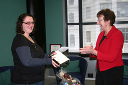 Mills & Boon winner receives prize from Jane Hill, Libraries Manager