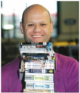 Customer holding DVDs