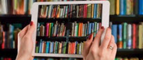 tablet in front of bookshelf