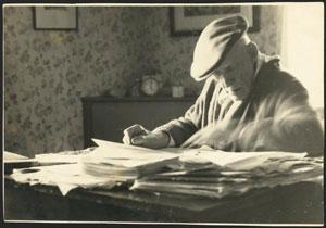 James Cowan at his desk, writing
