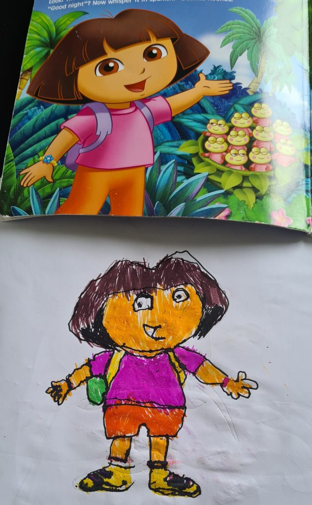 A hand-drawn and vibrantly-coloured Dora the Explorer sits beneath the original art from the book.
