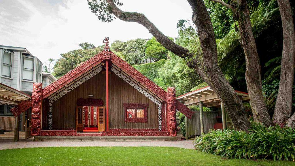 The image is of the marae of Victoria University Wellington, called Te Herenga Waka