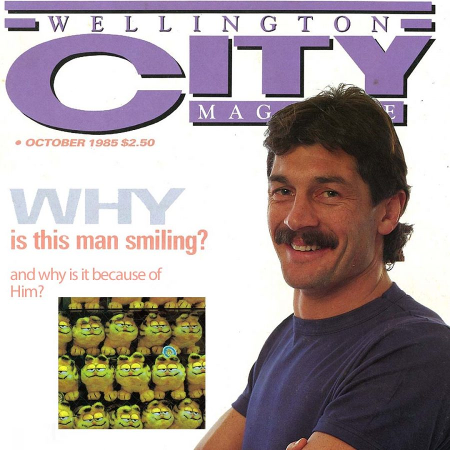 """A man stands proud on the cover of Wellington City Magazine, with the found caption """"Why is this man smiling"""". Alayne has photoshopped a picture of a bunch of Garfield toys with the answer """"and why is it because of him?""""."""