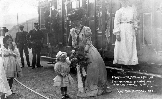 Opening of the Seatoun tram line (Miss Molly Fabian presenting boquet [sic] to the Lady Mayoress, 17/12/07) /'Zak', photo.