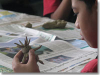 Katele Faimalie-Malutafa,10, puts the finishing touches to his spiky looking creation