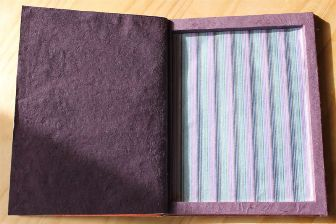 inside with stripey lining paper